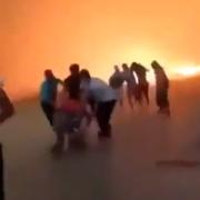 Minst 69 døde etter skogbranner – her løper innbyggerne for livet