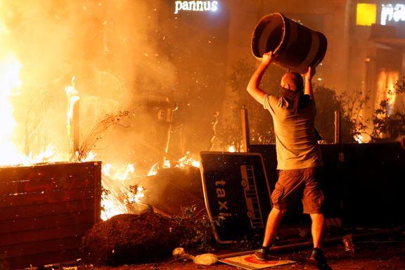 Politiet ba folk holde seg unna sentrum - se bildene fra de voldsomme gatekampene i Barcelona