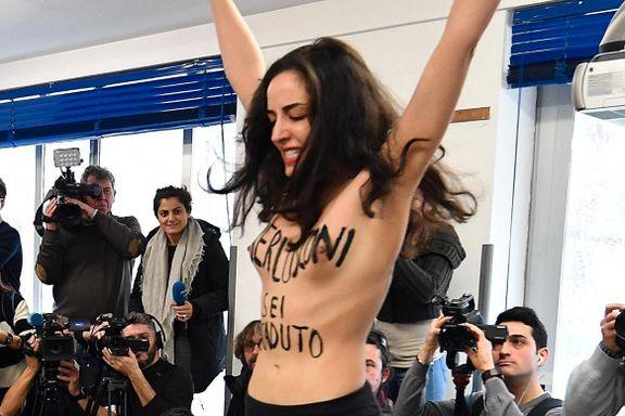 Berlusconi møtt med nakenprotest i Milano