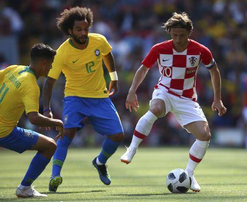 Oppveksten var ikke lett for Luka Modric (til høyre). Men han har gått gradene. Fra kroatisk fotball, til stjerne i Tottenham, til å være Real Madrid-spiller og regnet som verdens kanskje beste midtbanespiller.